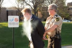 Parking officer issuing ticket to tobacco-free policy violator